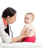 Doctor examining kid girl isolated on white — Stock Photo