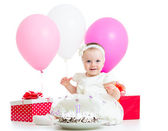 Joyful baby girl with cake, balloons and gifts. Isolated on whit — Stock Photo