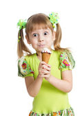 Funny kid girl eating ice cream in studio isolated — Stock Photo