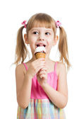 Little girl eating ice cream in studio isolated — Stock Photo