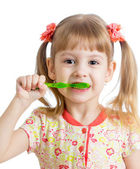 Child girl cleaning teeth , isolated on white background — Stockfoto