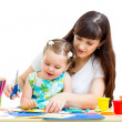 Mother and child draw and cut together — Stockfoto