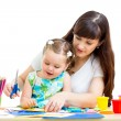 Mother and child draw and cut together — Stock Photo #27730407
