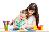Mother and child draw and cut together — Stock Photo