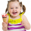 Happy kid girl eating ice-cream in studio isolated — Foto Stock