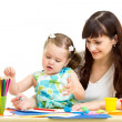Mother and kid girl draw together — Stockfoto