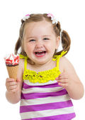 Happy kid girl eating ice-cream in studio isolated — Stock Photo