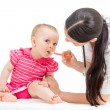 Stock Photo: Doctor giving remedy to kid girl isolated on white
