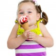 Funny kid girl eating ice cream isolated — Stock Photo #27921213