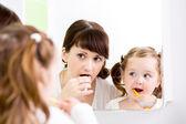 Mother teaching kid teeth brushing — Stock Photo
