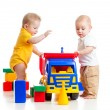 Two little kids playing with color toys — Stock Photo #28156407