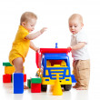 Stock Photo: Two little kids playing with color toys