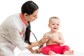 Doctor examining smiling baby isolated on white — Stock Photo