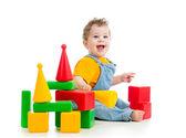 Smiling child playing building blocks — Stock Photo