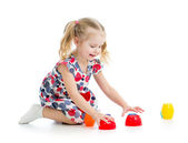 Girl child playing with cup toys, isolated over white — Stock Photo