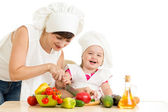 Chef mom and kid preparing healthy food — Stock Photo
