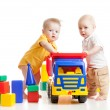 Two little children play with block toys — Stock Photo
