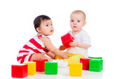 Babies girls play block toy — Stock Photo