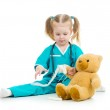 Kid girl playing doctor with toy — Stock Photo #31034079