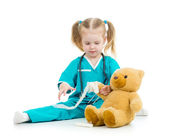Kid girl playing doctor with toy — Stock Photo