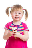 Happy kid girl eating ice cream in studio isolated — Stock Photo