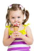 Kid girl eating ice cream in studio isolated — Stock Photo