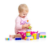 Child girl playing with construction set over white background — Foto Stock