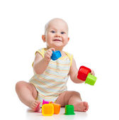 Baby boy playing with cup toys — Stockfoto