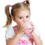 Kid drinking yoghurt from glass — Stock Photo