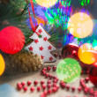 Christmas tree with bauble and cake over bright festive backgrou — Stock Photo