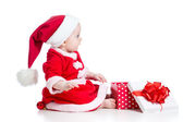 Christmas baby girl opening gift box isolated on white backgroun — Stock Photo