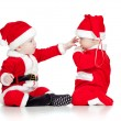 Two funny small kids in Santa Claus clothes isolated on white ba — Stock fotografie