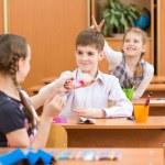 Schoolchildren at lesson in classroom — Stock Photo #31663981