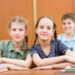 Schoolchildren in classroom — Stockfoto