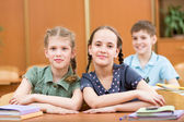 Schoolchildren in classroom — Stock Photo