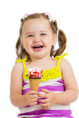 Happy kid girl eating ice cream in studio isolated — Stock Photo