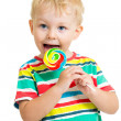 Kid boy eating lollipop isolated — Foto de Stock