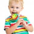 Kid boy eating lollipop isolated — Stock Photo