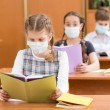 Stock Photo: School kids with protection mask against flu virus at lesson