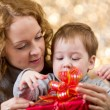 Mother and son with gift — Stock Photo
