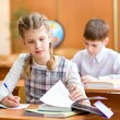 School kids at lesson — Stock Photo #31995549