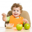 Baby eating by himself — Stock Photo #32247003