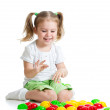 Little girl kid playing with mosaic toy — Stock Photo
