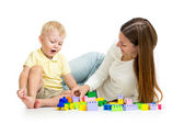 Child and his mom play together with block toy — Stock Photo