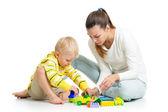 Kid boy and mother play together with construction set toy — Foto Stock