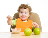 Baby eating by himself — Stock Photo