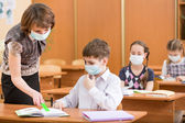 School kids and teacher with protection mask against flu virus a — Stock Photo
