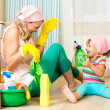 Happy mother with kid cleaning room and having fun — Stock Photo #33057491
