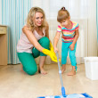 Mother and kid clean room and having fun — Stock Photo