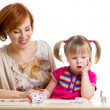 Kid and mother have pastime together — Stock Photo